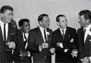 The Rat Pack enjoy a drink and a laugh together.